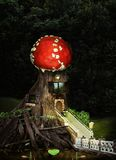 Tale of the mysterious forest life. Fantasy tree house in deep forest.A children`s collage about the life of fairy-tale forest residents with a house made of old vector illustration