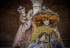 A Tale of Two Sisters. Masked models  of the Venetian Carnevale Stock Photo