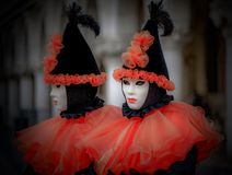 A Tale of Two Sisters. Masked models  of the Venetian Carnevale Royalty Free Stock Image