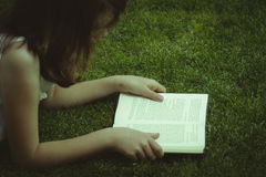 Tale.Young beautiful girl reading a book outdoor Stock Photo
