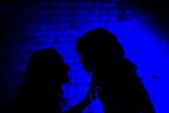 Talebearer - Two Girls Chat In Private Stock Photo