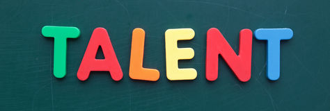 Talent. The term talent in colorful letters on a blackboard stock photo