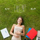 Talent against pretty student lying on grass Stock Photo