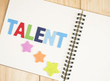 Talent management 1. Word spell Talent and star on blank notebook with wood background (Business Concept stock image