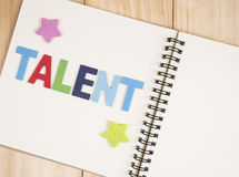 Talent management 3. Word spell Talent and star on blank notebook with wood background (Business Concept royalty free stock photography