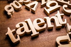 Talent Wood Word. In scattered letters on the table royalty free stock image