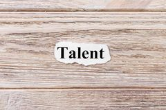 Talent of the word on paper. concept. Words of talent on a wooden background.  stock photos