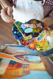 Talented Artist painting Beautiful Picture in Studio Stock Photography