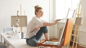 Talented artist sitting on table and drawing her picture at home. Interest, hobby concepts stock video footage
