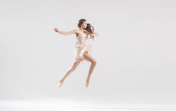 Talented ballet dancer in athletic jump Stock Photos