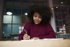 Talented blogger creating article noting ideas with pen Stock Image