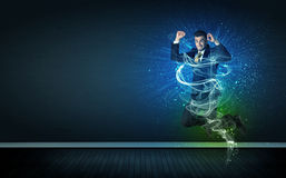 Talented cheerful businessman jumping with glowing energy lines Stock Photos