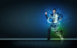 Talented cheerful businessman jumping with glowing energy lines Stock Image