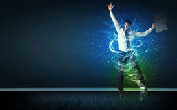 Talented cheerful businessman jumping with glowing energy lines Royalty Free Stock Images