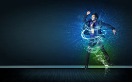 Talented cheerful businessman jumping with glowing energy lines Stock Photo