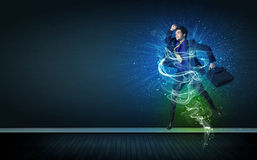 Talented cheerful businessman jumping with glowing energy lines Royalty Free Stock Photo