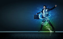 Talented cheerful businessman jumping with glowing energy lines Royalty Free Stock Image