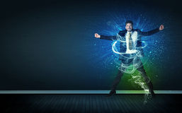 Talented cheerful businessman jumping with glowing energy lines Royalty Free Stock Photos