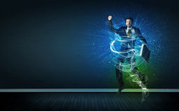 Talented cheerful businessman jumping with glowing energy lines Stock Images