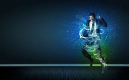 Talented cheerful businessman jumping with glowing energy lines stock photography