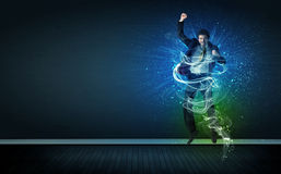 Free Talented Cheerful Businessman Jumping With Glowing Energy Lines Royalty Free Stock Photography - 50452957
