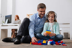 Talented child and her dad playing with construction kit Stock Image