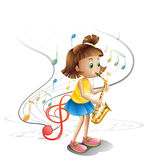 A talented child with a saxophone Royalty Free Stock Image