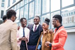 Talented cooperate people rejoicing at the good news. Outdoors. old school ties royalty free stock photography