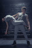 Talented dancers performing in close interaction with each other Stock Images