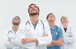 Talented doctor looking at the top, on the copy space Royalty Free Stock Photo