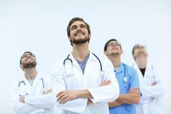 Talented doctor looking at the top, on the copy space Stock Photos