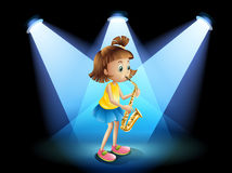 A talented girl at the center of the stage Royalty Free Stock Photo