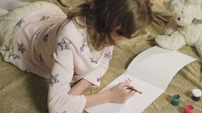 Talented girl neatly drawing with gouache beautiful flowers in her album, hobby. Stock footage stock video