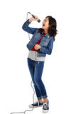 Talented girl. Studio shot of talented mixed-race girl singing in microphone Stock Photo