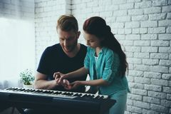 Talented girl teaches redheaded father royalty free stock image