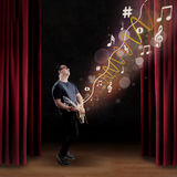 Talented guitarist perform on a stage Royalty Free Stock Photos