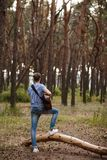 Talented guitarist playing forest hiking concept. Lifestyle of the artist. Unity with the nature Stock Photography