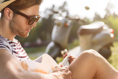 Talented guitarist playing musical instrument Royalty Free Stock Image