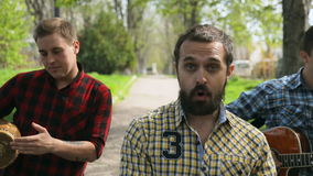 Talented guys in plaid shirt walking down the stock video footage