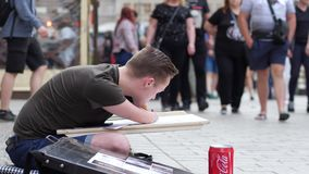 Talented handicapped men draws paintings on street on side road. Wroclaw, Poland 12 May 2018: talented handicapped men draws paintings on street on side road in stock video