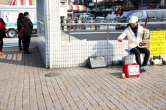 Talented Japanese street performer  busking at the traffic lights Royalty Free Stock Images