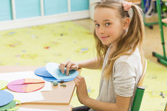 Talented little artist. Shot of a young girl taking art class Royalty Free Stock Images