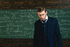 Talented mathematician. Genius solved mathematics problem.Teacher smart student intrested math physics exact sciences. Man formal wear classic suit looks smart royalty free stock photos