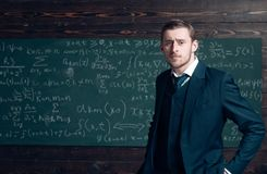 Talented mathematician. Teacher smart student intrested math physics exact sciences. Man formal wear classic suit looks. Smart, chalkboard with equations stock images