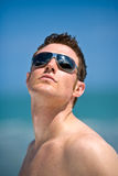 Talented model. Young handsome Caucasian man with sunglasses Royalty Free Stock Images