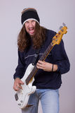 Talented musician playing bass guitar Stock Photo