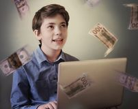 Talented teenager with laptop freelance working earn money. Talented successful ambitious teenager boy with laptop freelance working earn money on internet royalty free stock photo