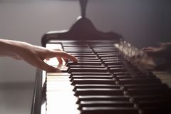 Talented woman playing piano