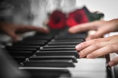 Talented woman playing piano Royalty Free Stock Photo