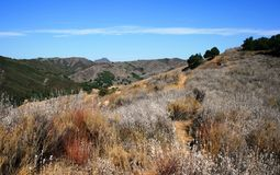 Talepop Trail. Trail through hills beneath blue sky, Malibu, CA Stock Photos